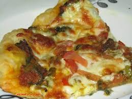 پیتزای گوشت و اسفناج یک پیتزای سالم مقوی و لذیذ! +عکس