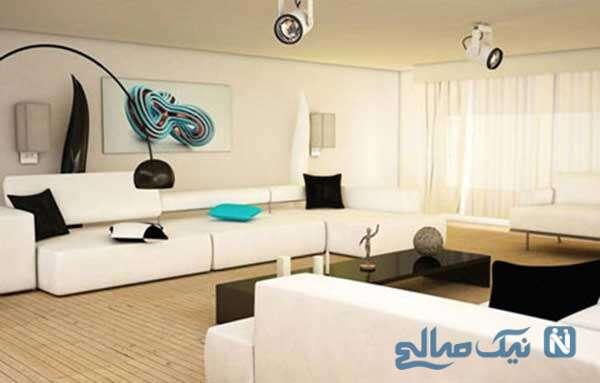برای داشتن یک اتاق بزرگ، دیوارها را سفید و وسایل منزل را مشکی کنید