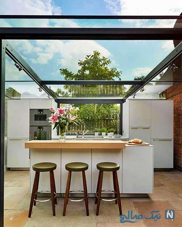 فضای داخلی آشپزخانه شیشه ای بر روی بام