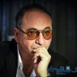 عکس حمید فرخ نژاد در کنار ماشین لاکچری
