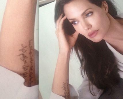 خالکوبی روی دست آنجلینا جولى