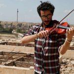 کنسرت امین موکداد ویولونیست عراقی برروی ویرانه ها+تصاویر