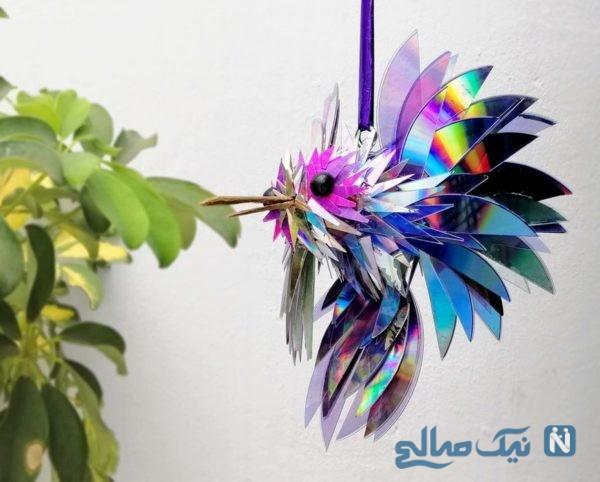 ساخت مجسمه با سی دی به شکل پرنده زیبا و رنگین کمانی