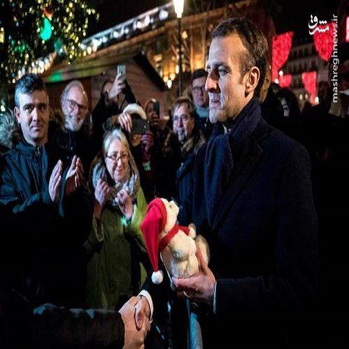 ادای احترام مکرون به کشته شدگان بازار کریسمس