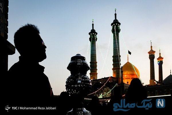 تصاویری زیبا از تعویض پرچم گنبد حرم حضرت معصومه (س)