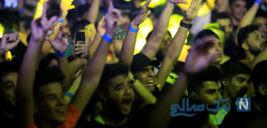 رقص و پایکوبی دختران و پسران در استادیوم بغداد