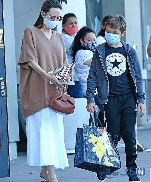 خانم بازیگر و پسرش با ماسک