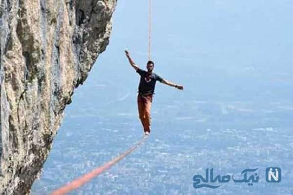 تصاویر عجیب از پیاده روی مرد جوان روی بلندترین برج تلویزیونی با طناب