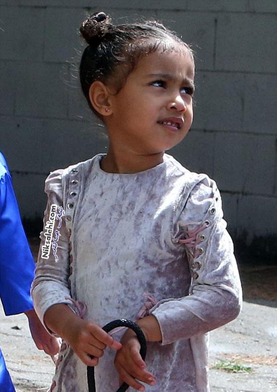 کیف دستی گرانقیمت در دست دخترکوچولوی کیم کارداشیان و کانیه وست +عکس